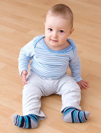 0 1 months: beautiful laughing baby boy sitting