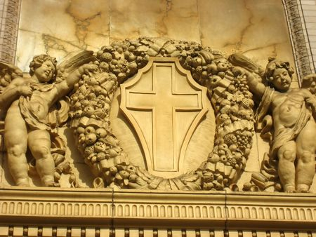 Detail of angels and cross sculpture on St. Ignatius church in San Francisco, CA Stock Photo