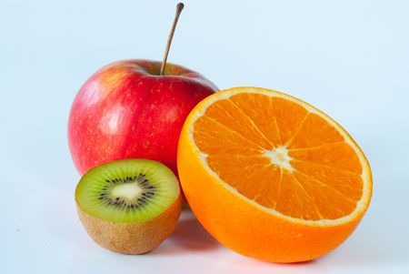 Whole red apple accompanied by a sliced kiwi and an sliced orange isolated on a white background photo