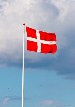 Danebrog flying danish flag Фото со стока - 81930820