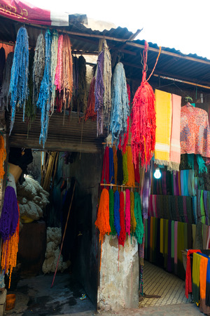 bunches: dyed bunches of wool hanging to dry in marrakeshs dyers souk, morocco