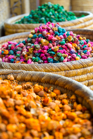 heaps of spices on display on market in morocco
