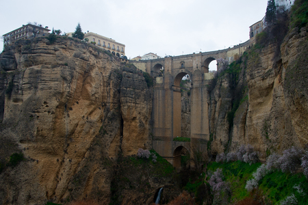 ancient bridge, connecting old and new part of andalusian town ronda over gorge el tajo of  Río Guadalevín Banco de Imagens