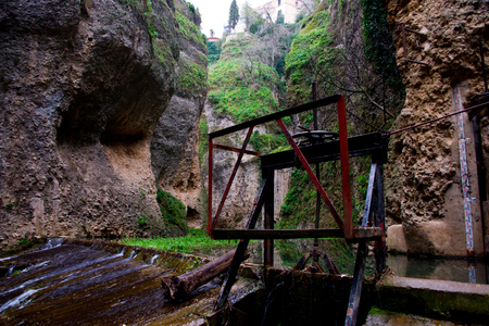 irrigation sluice system with rusty shutoff wheel in ronda, andalusia, spain Stock Photo