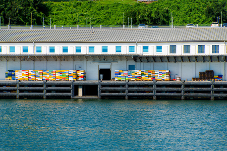 fishery dock with colorful crates at sassnitz port, ruegen island, germany