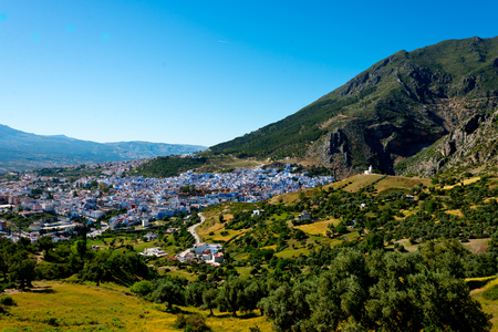 cityscape of famous blue town chefchaouen in rif mountains, morocco Standard-Bild - 115629025