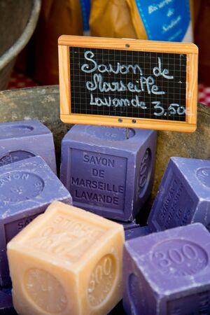 Bars of scented soap at market stall in provence province, france