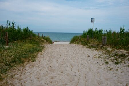 beach path at baltic seashore wit warning signs, mecklenburg western pomerania, germany