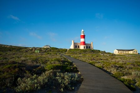 lighthouse at cape agulhas, southernmost point of africa, where atlantic and indian oceans meet