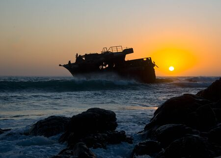 sunset behind shipwreck of japanese trawler meisho maru no 38 near cape agulhas 写真素材