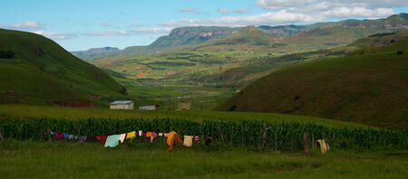rural homestead with colorful clothesline in drakensberg mountains, kwazulu natal, south africa