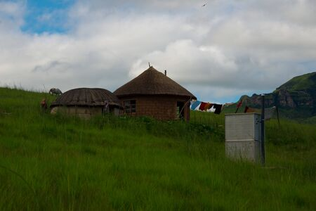 rural homestead with pit latrine in drakensberg mountains, kwazulu natal, south africa