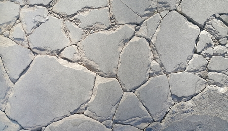 Cracked cement floor,stone apart,background ,cambered,texture,split,circle,pieces