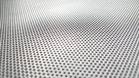 metallic mesh part of microphone and loudspeaker. background,texture,dot ( photo intended : vintage style,blur) Stock Photo