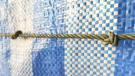 Focus rope with knot isolated on blue shading net.node,spiral,lasso