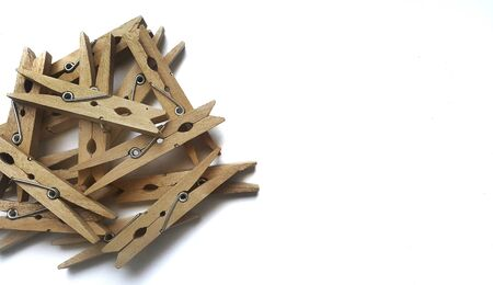 Wooden clothes clips on white  background