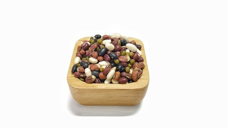 five mixed beans on wooden bowl isolated on white background. raw beans,organic super food. Stock Photo