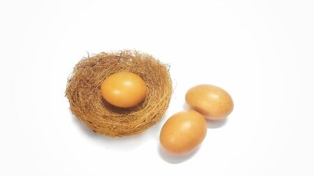 Three eggs in bird's nest isolated on white background.Nutritional value Imagens - 98842488