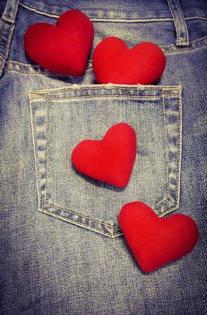 4 hearts isolated on blue jean background with copy space. 14 February.Valentine day. I love you.