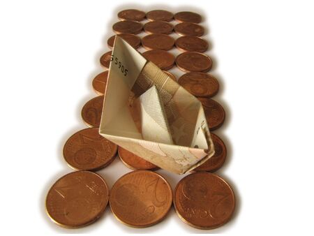 succes: Money ship floating on euro coins Stock Photo