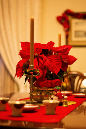 Dining table with holidays decorations on a warm environment