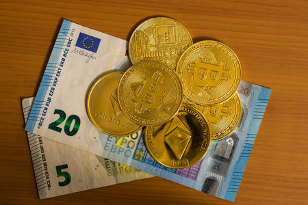 Euro bills and bitcoins Stock Photo