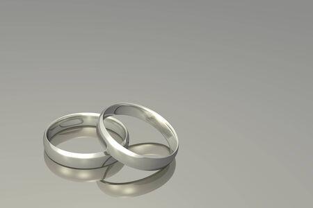 wedding bands: Silver wedding bands on a grey background.
