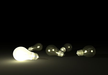 Lit bulb next to unlit light bulbs.