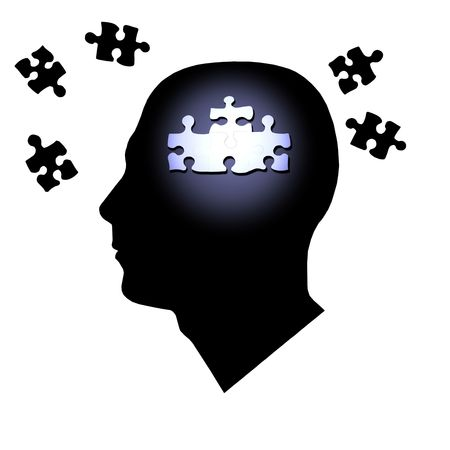 Puzzle pieces inside and outside of a mans head.