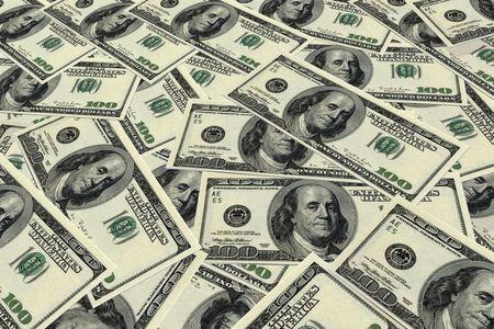 fake money: Background image of U.S. hundred dollar bills.