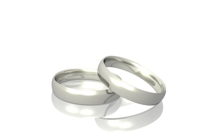 Two silver or platinum rings isolated on a white background. Stock Photo