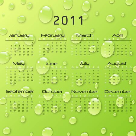 Image of a 2011 calendar with green rain drop background. photo