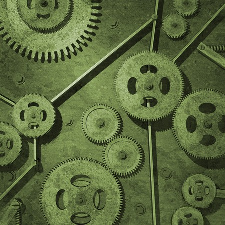 Various rusty metal gears on a green background. photo