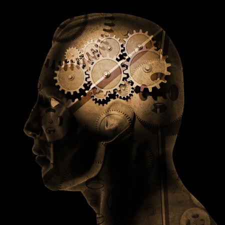 Image of various gears inside of a man's head on a black background. Standard-Bild