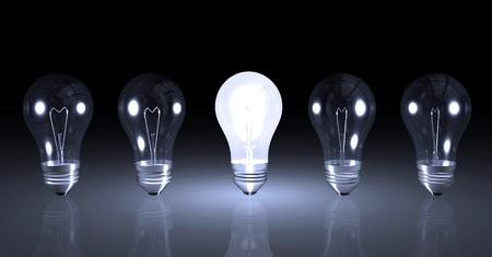 Beeld Eén verlichte gloeilamp naast andere onverlichte lampen. Stockfoto - 8490574