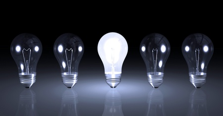 Image one lit light bulb next to other unlit bulbs. Stockfoto