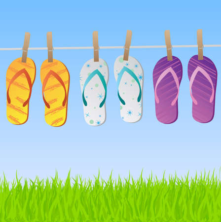 footware: Image of a colorful scene with flip flops hanging on a clothes line with sky and grass.