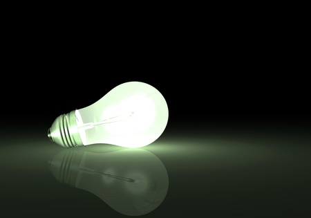 Image of a light bulb with reflection on a dark background.