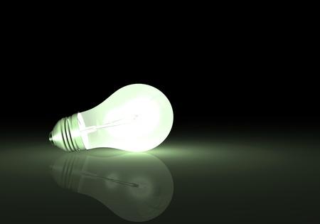 focos de luz: Imagen de una bombilla de luz con una reflexión sobre un fondo oscuro.