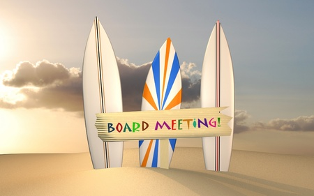 Concept image of a board meeting with surfboards on sand with a sunset background.