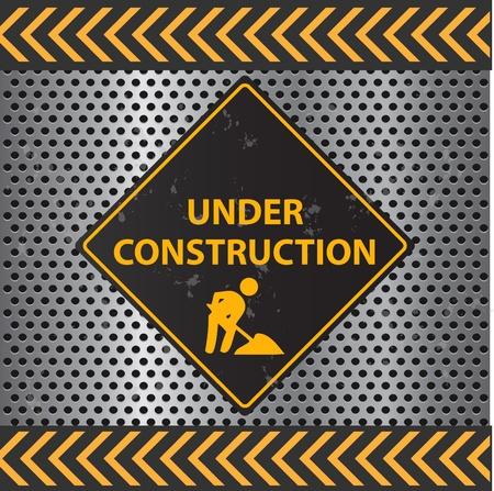 Immagine di un segno Under Construction con una texture di sfondo metallico. Archivio Fotografico - 9717565