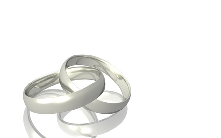 silver background: Image of two silver wedding bands isolated on a white background.
