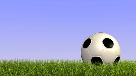 Image of a soccer ball on grass against a blue sky background. photo