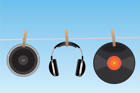 Concept image of audio items hanging on a clothesline.