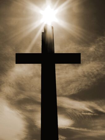 good friday: Image of a cross with sun and lens flare.