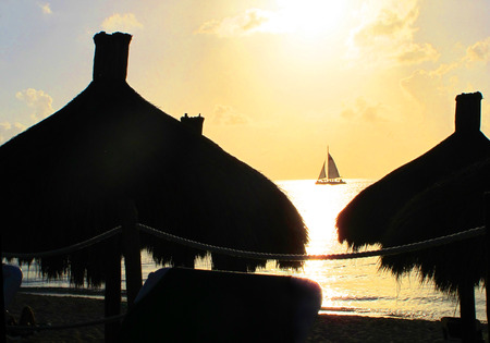 palapa: Image of palapas against a sunset sky at a tropical resort. Stock Photo