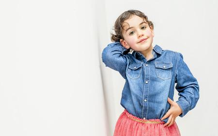 Little girl posing in studio for the photographer