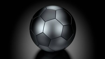 low key lighting: Soccer ball  in Low Key Lighting over a black background. Part of a series. Stock Photo