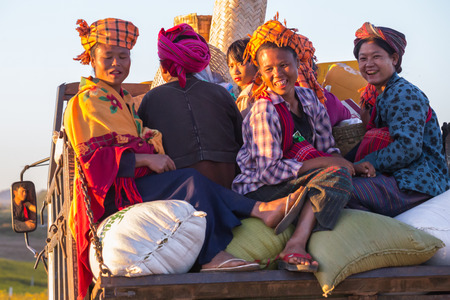 come home: KALAW, MYANMAR - NOVEMBER 28, 2014: many peasants in Burmese traditional clothes come home in the evening after a days work on the fields near Kalaw