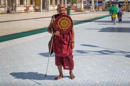 pilgrimage: YANGON, MYANMAR - NOVEMBER 22, 2014: an unidentified Buddhist monk goes on pilgrimage to Botataung Pagoda in Yangon, Myanmar.